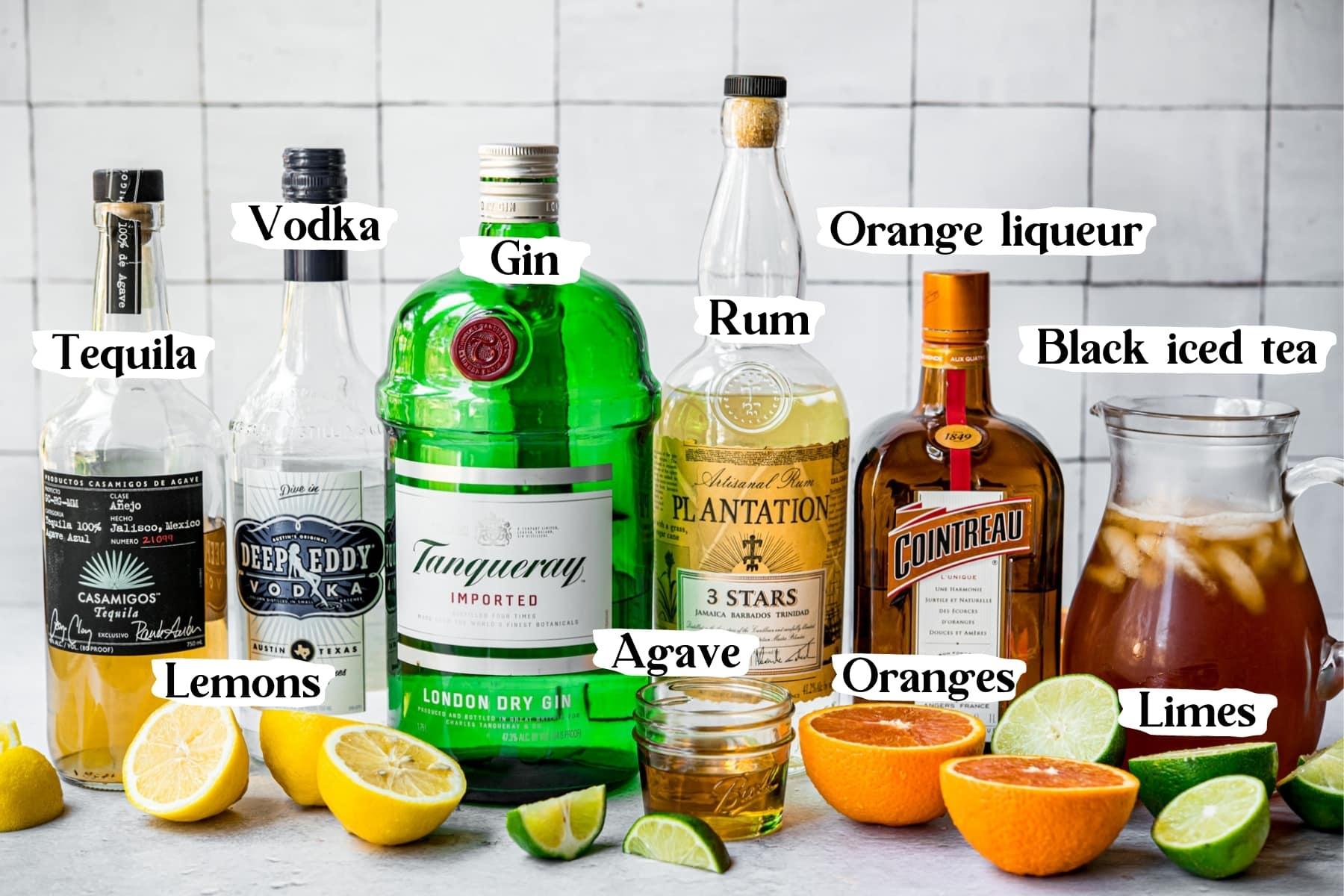 Long island iced tea ingredients: tequila, vodka, gin, rum, orange liqueur, black iced tea, lemons, agave, oranges, limes.