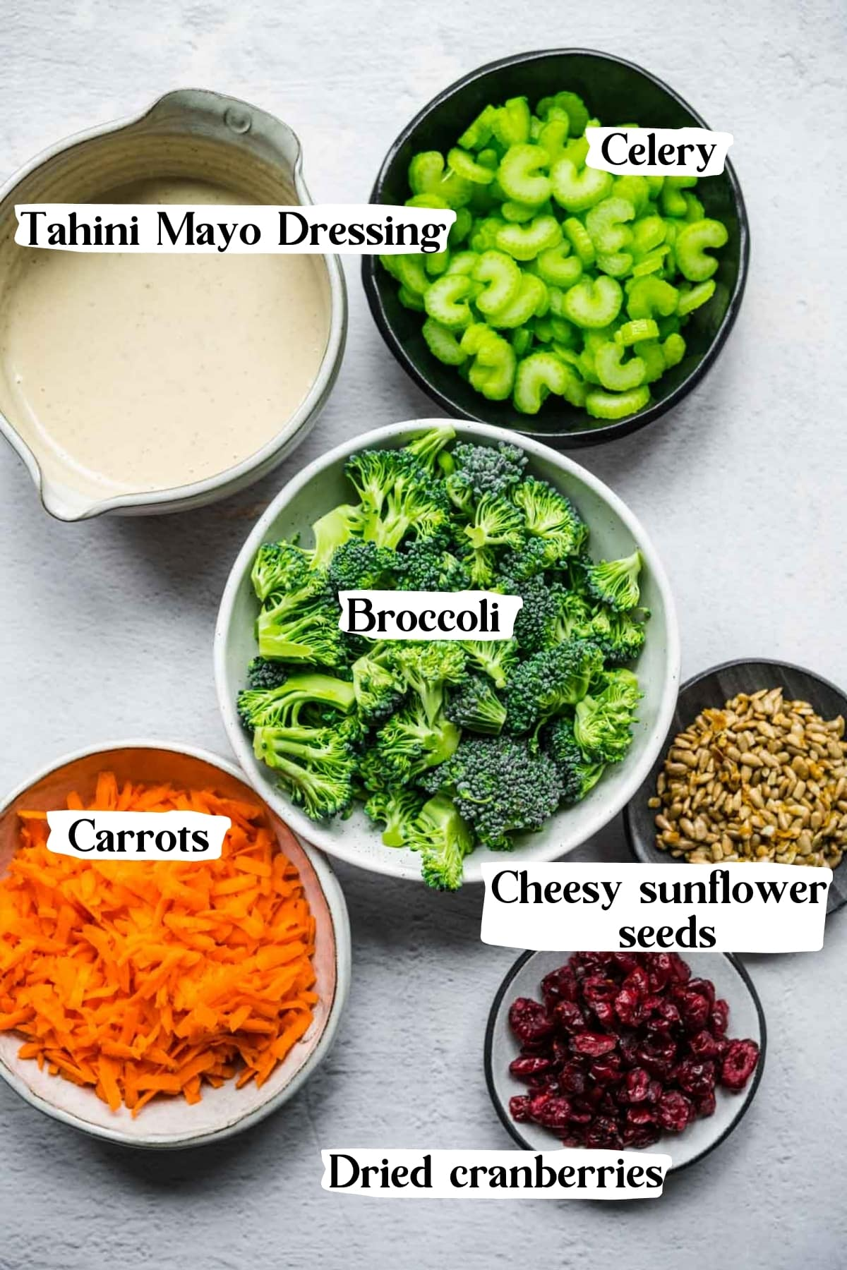 overhead view of ingredients for vegan broccoli salad in small prep bowls.