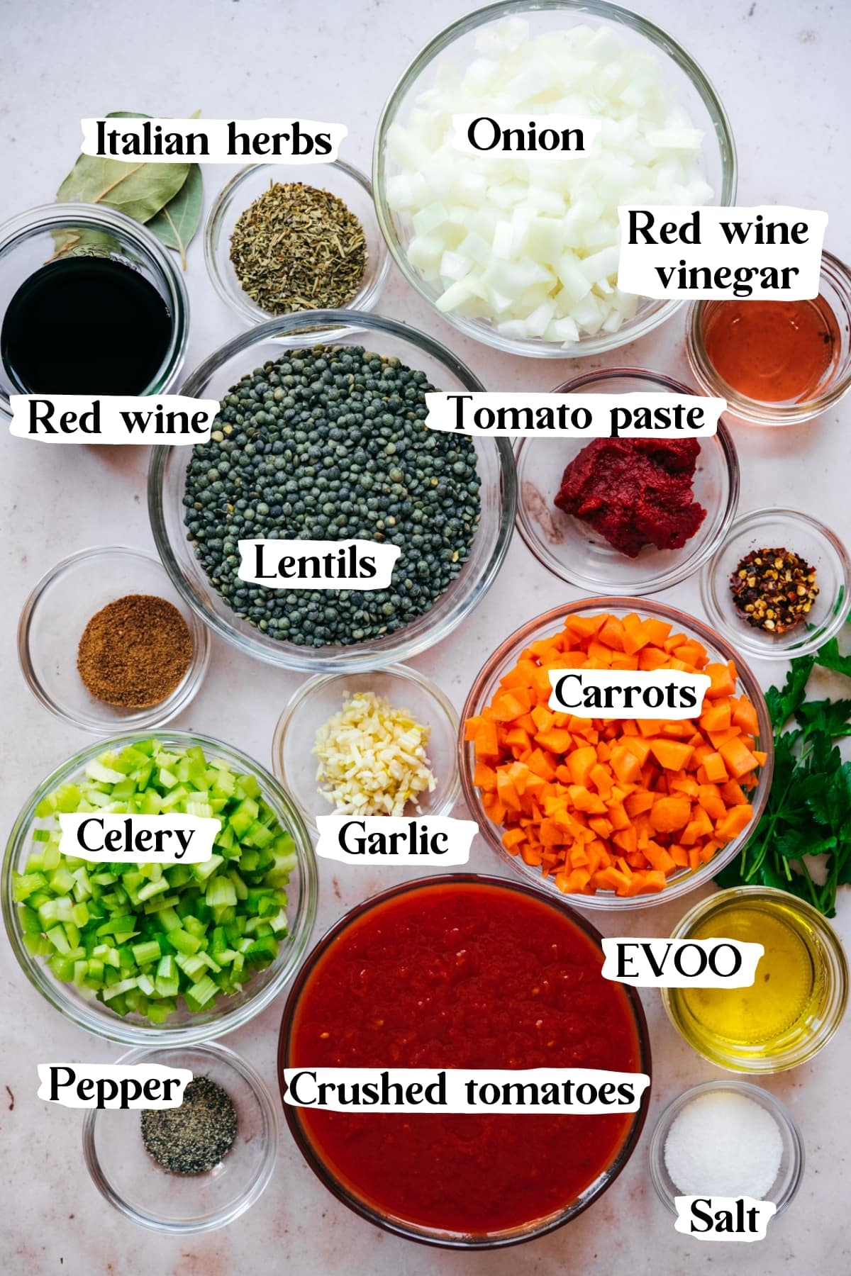 overhead view of ingredients for vegan lentil bolognese in small prep bowls.
