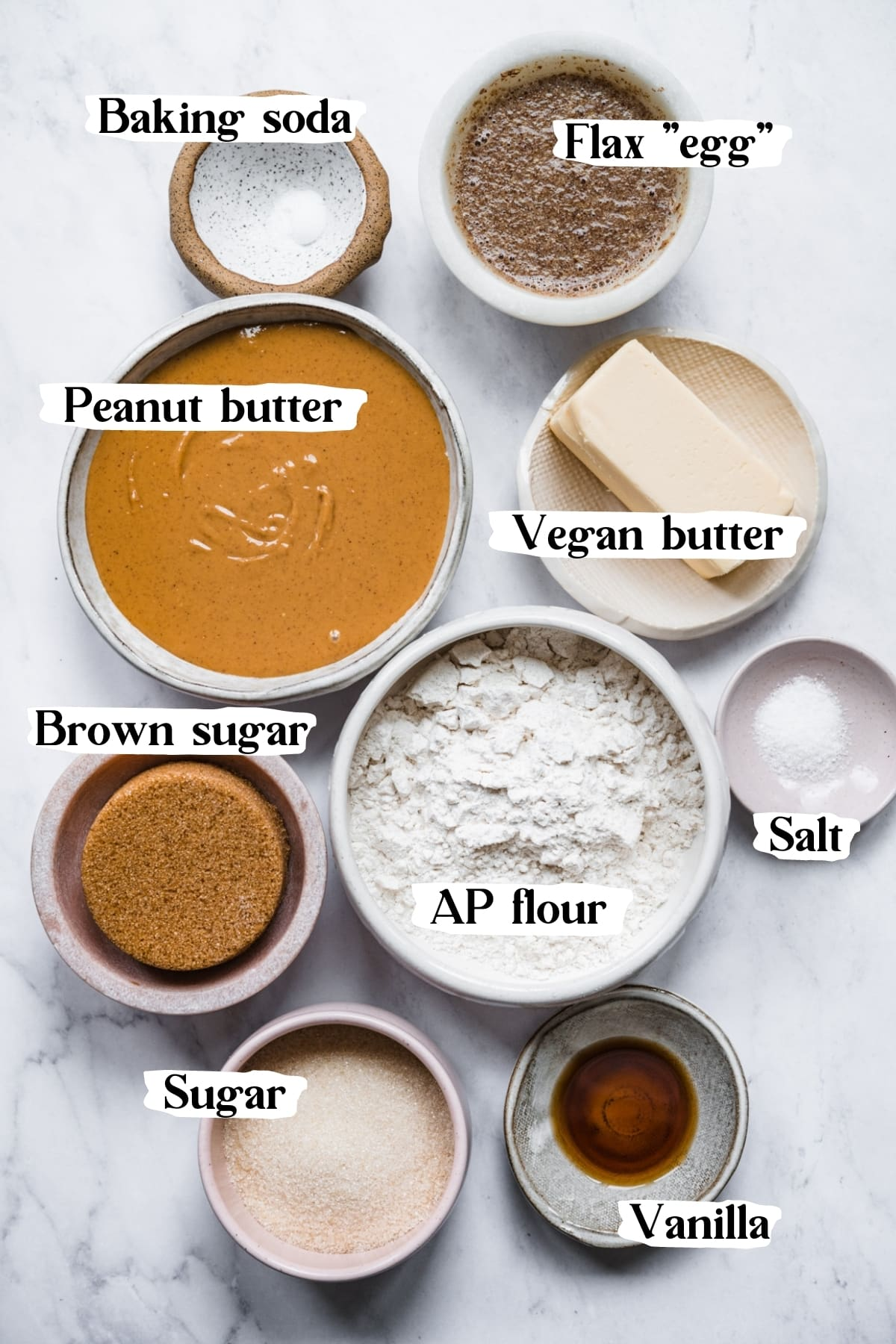 overhead view of ingredients for vegan peanut butter cookies in small prep bowls.