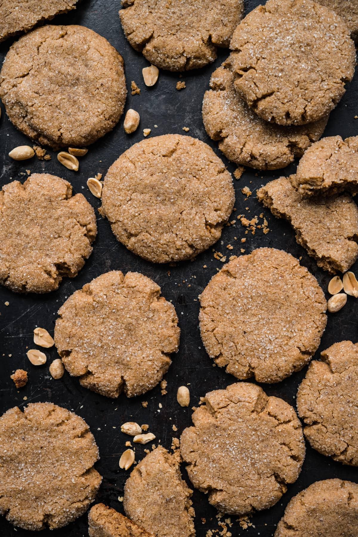 overhead view of vegan peanut butter cookies on baking sheet.