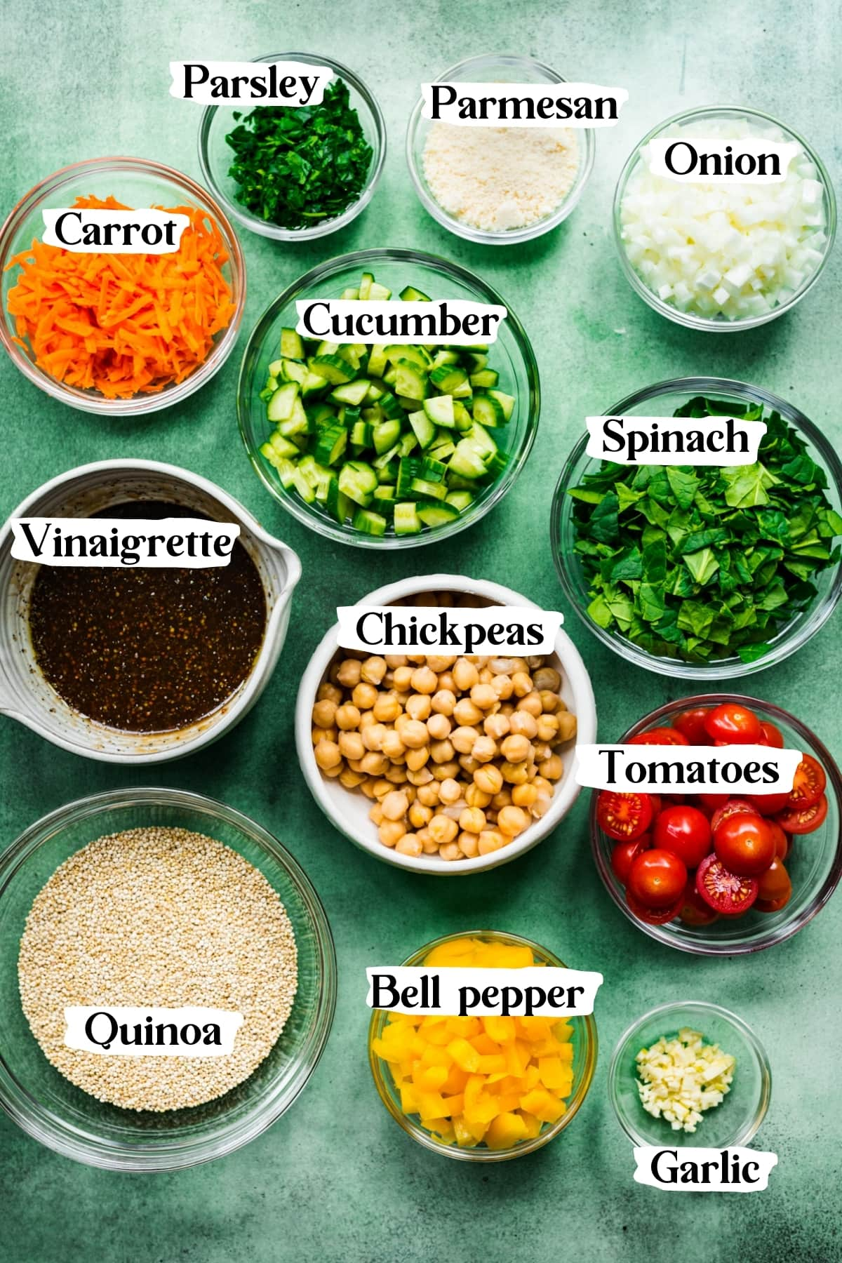 overhead view of ingredients for vegan quinoa chickpea salad in small bowls.