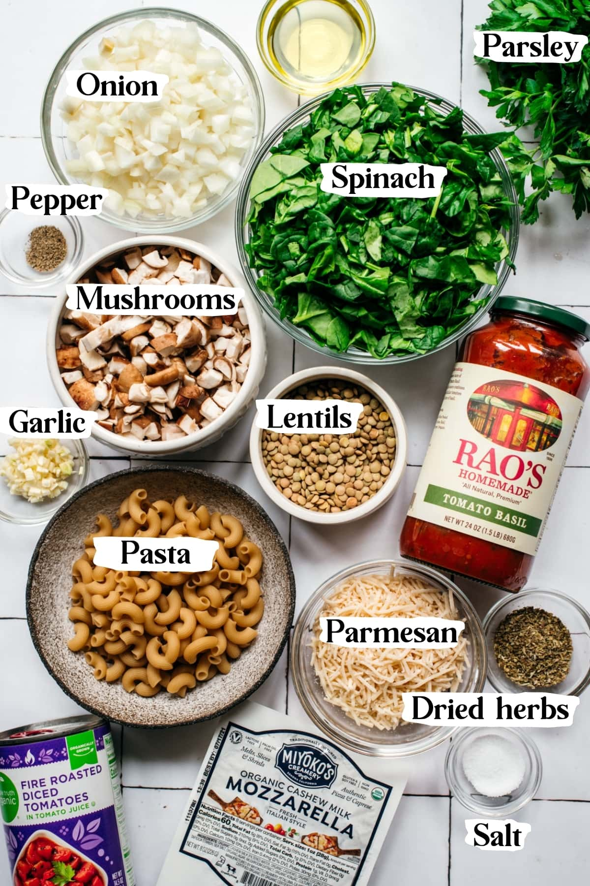 overhead view of ingredients for vegan pasta bake in small bowls.