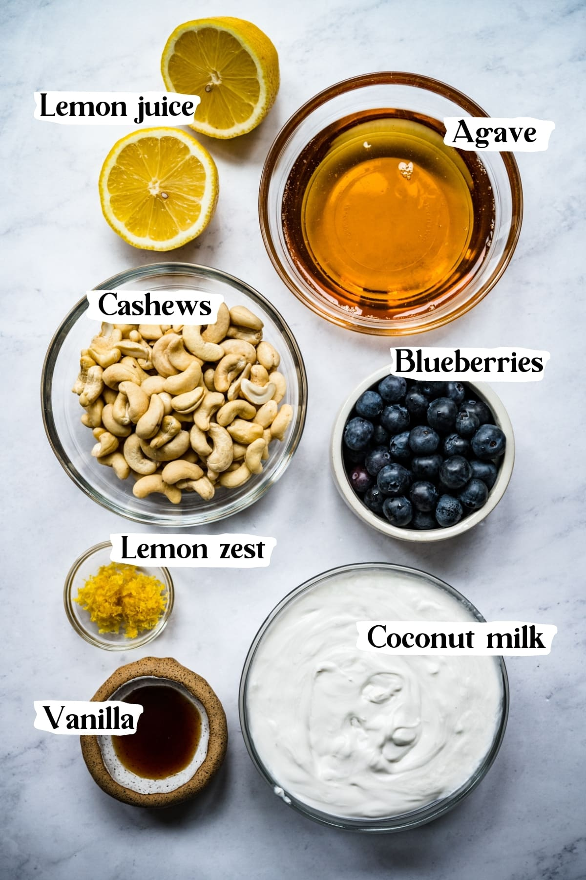 overhead view of ingredients for vegan blueberry lemon ice cream in small prep bowls.