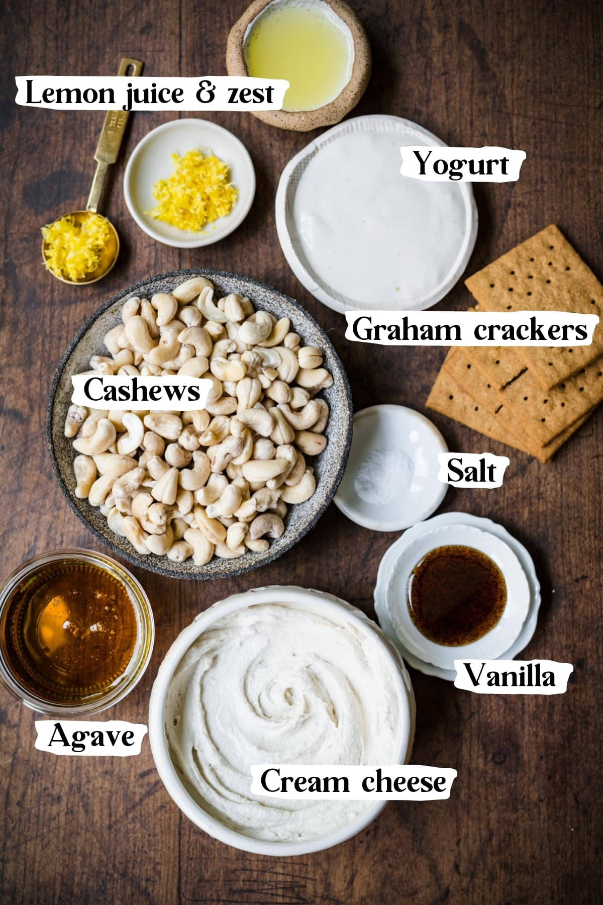 overhead view of ingredients for no bake vegan cheesecake, including cashews, cream cheese and graham crackers.