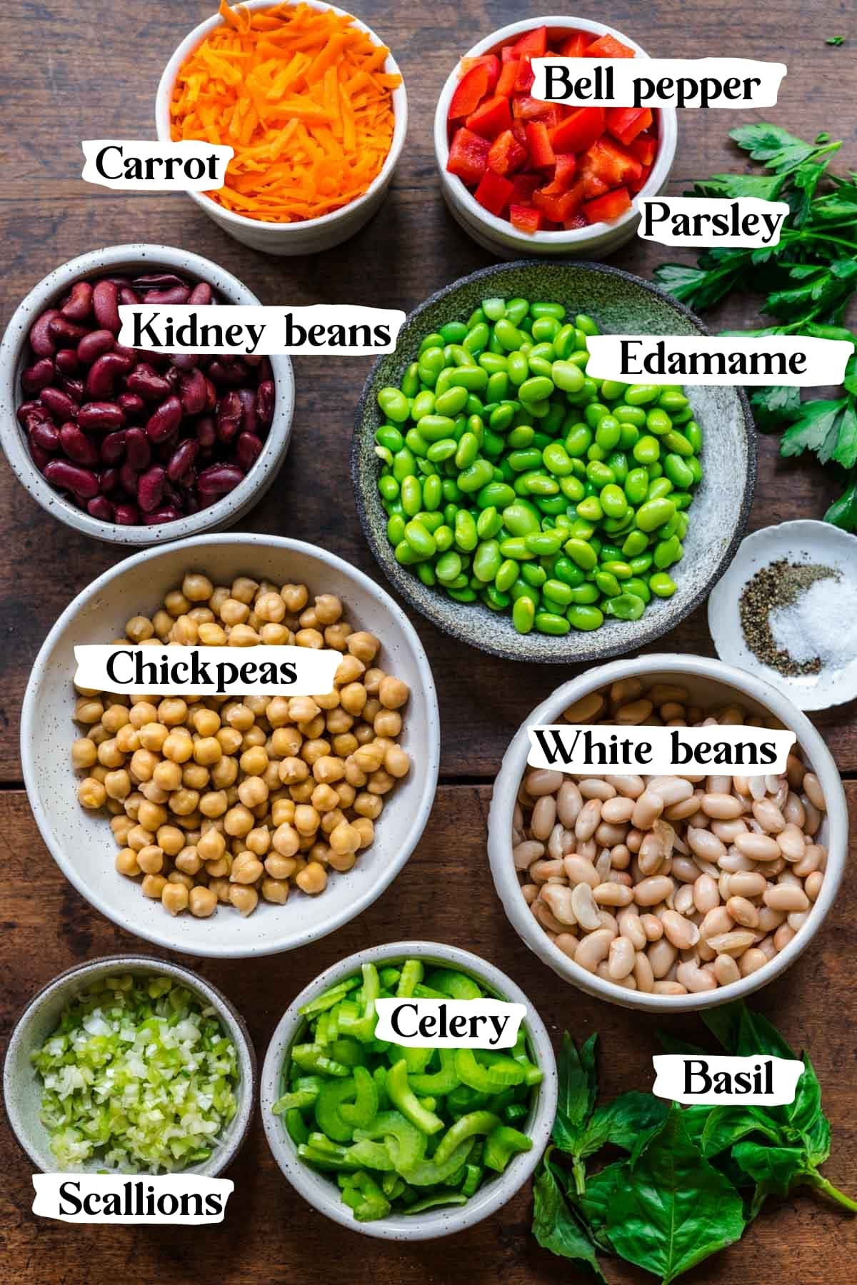 overhead view of ingredients for four bean salad in small prep bowls.