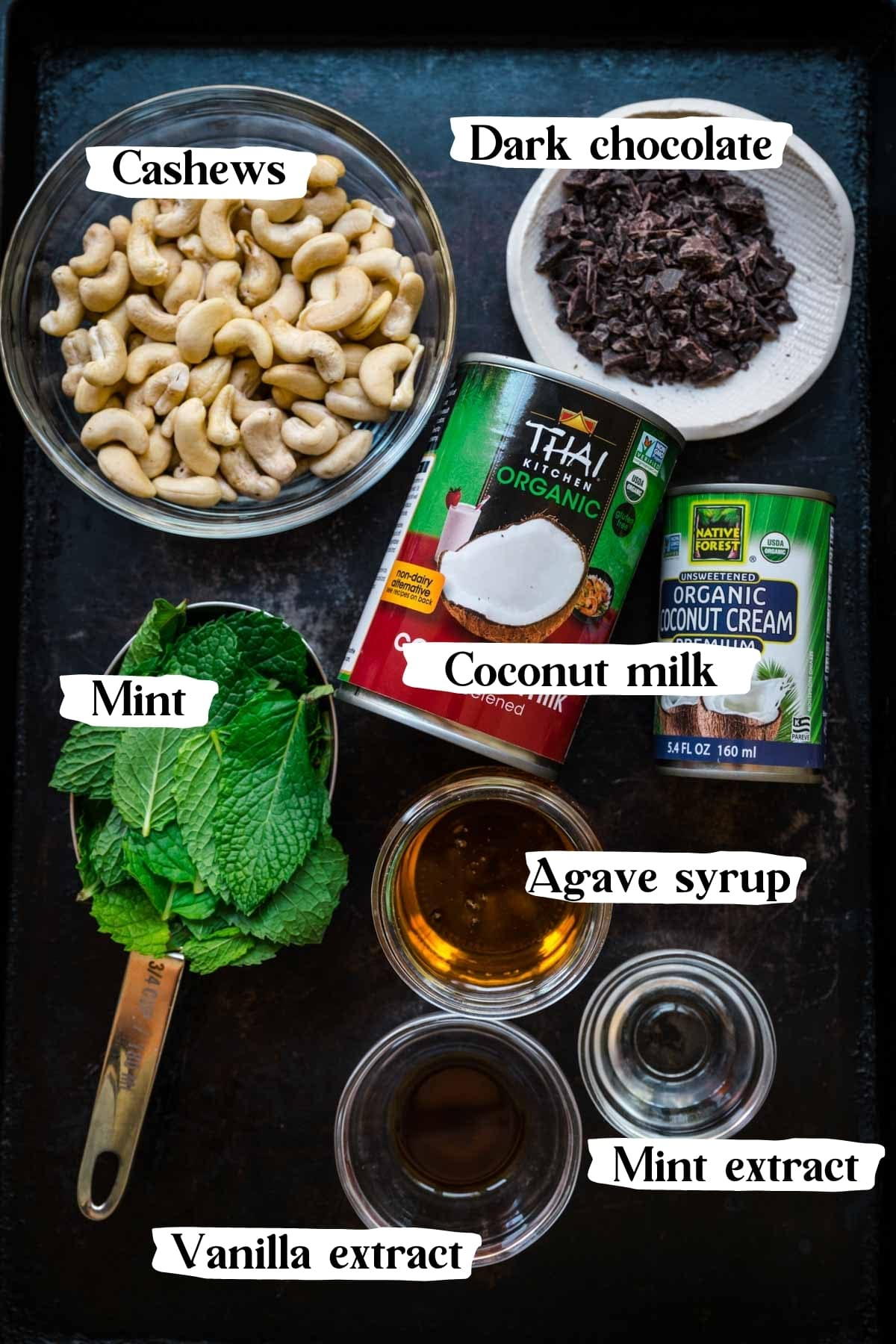 overhead view of ingredients for vegan mint chocolate chip ice cream on sheet pan.