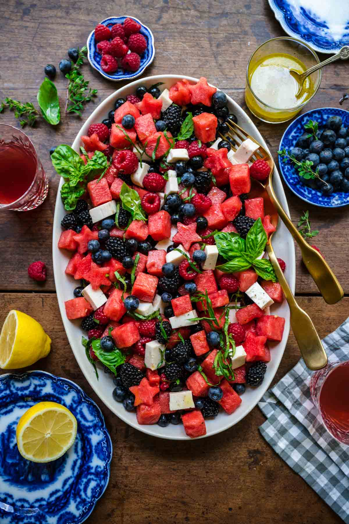 close up overhead view of red white and blue fruit salad on a platter.