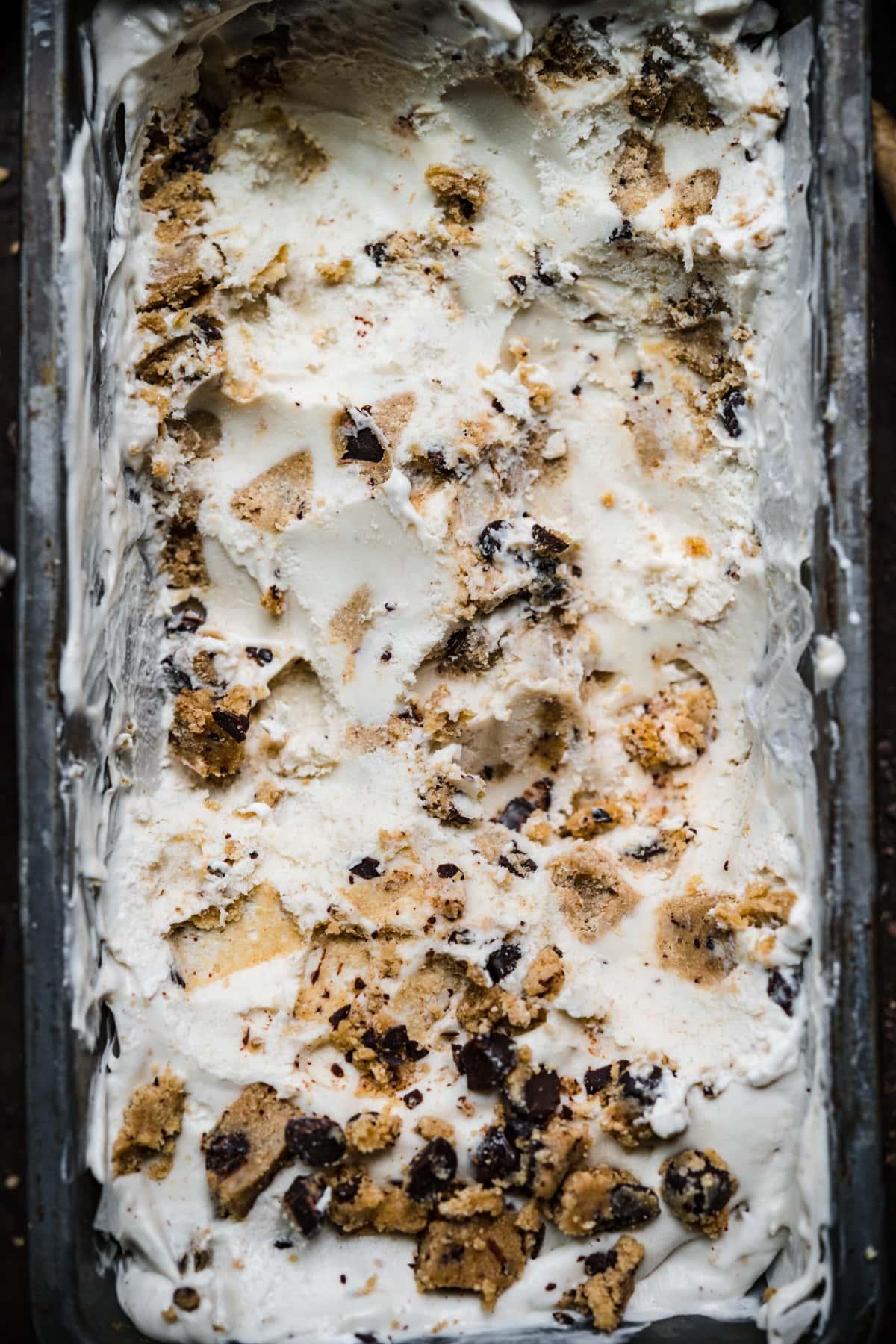 overhead view of vegan cookie dough ice cream in antique tin.