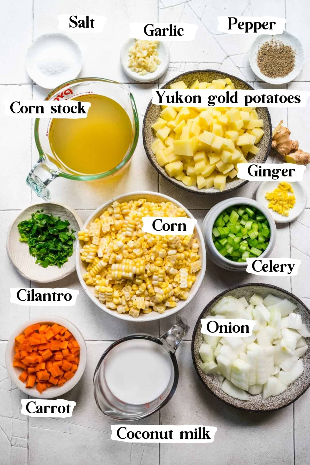 overhead view of ingredients for vegan corn chowder in small prep bowls.