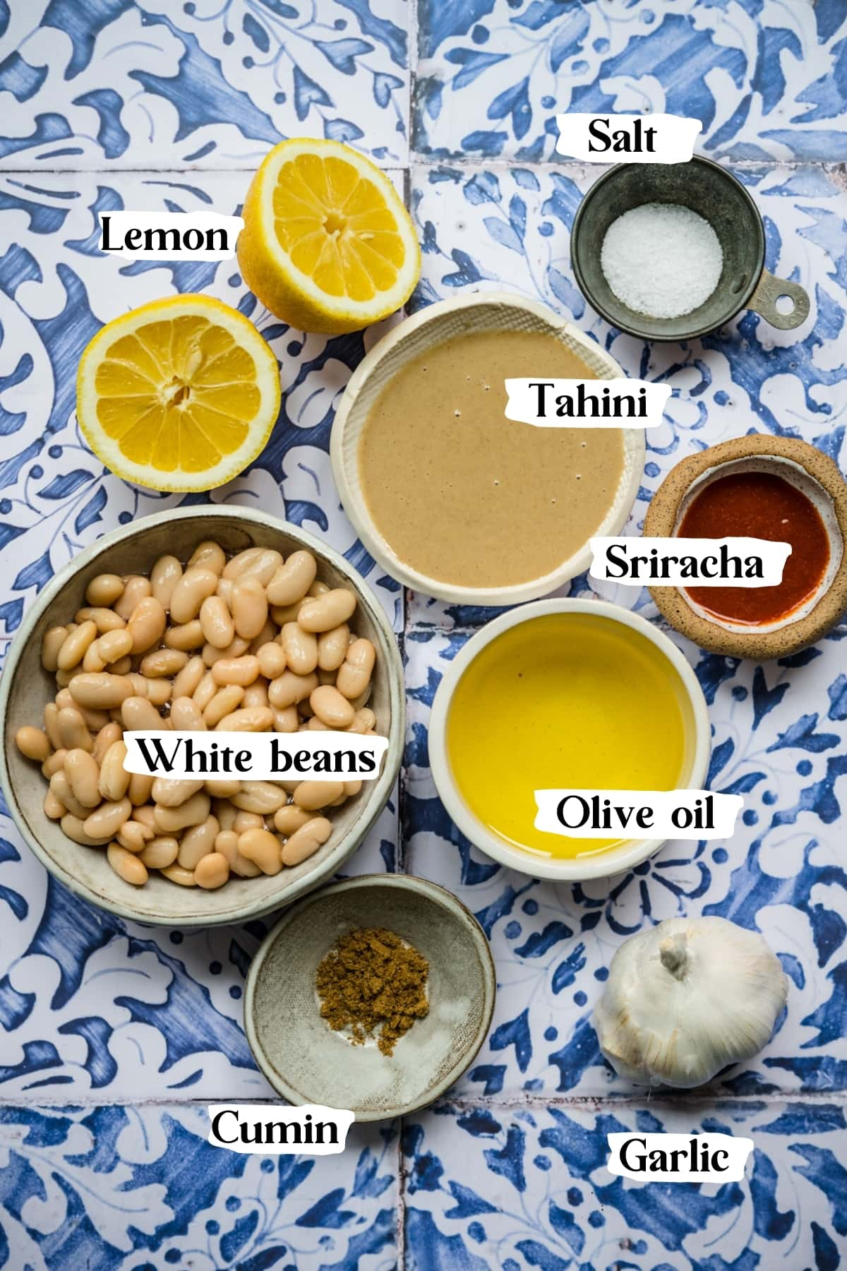 overhead view of ingredients for spicy white bean dip in small prep bowls.