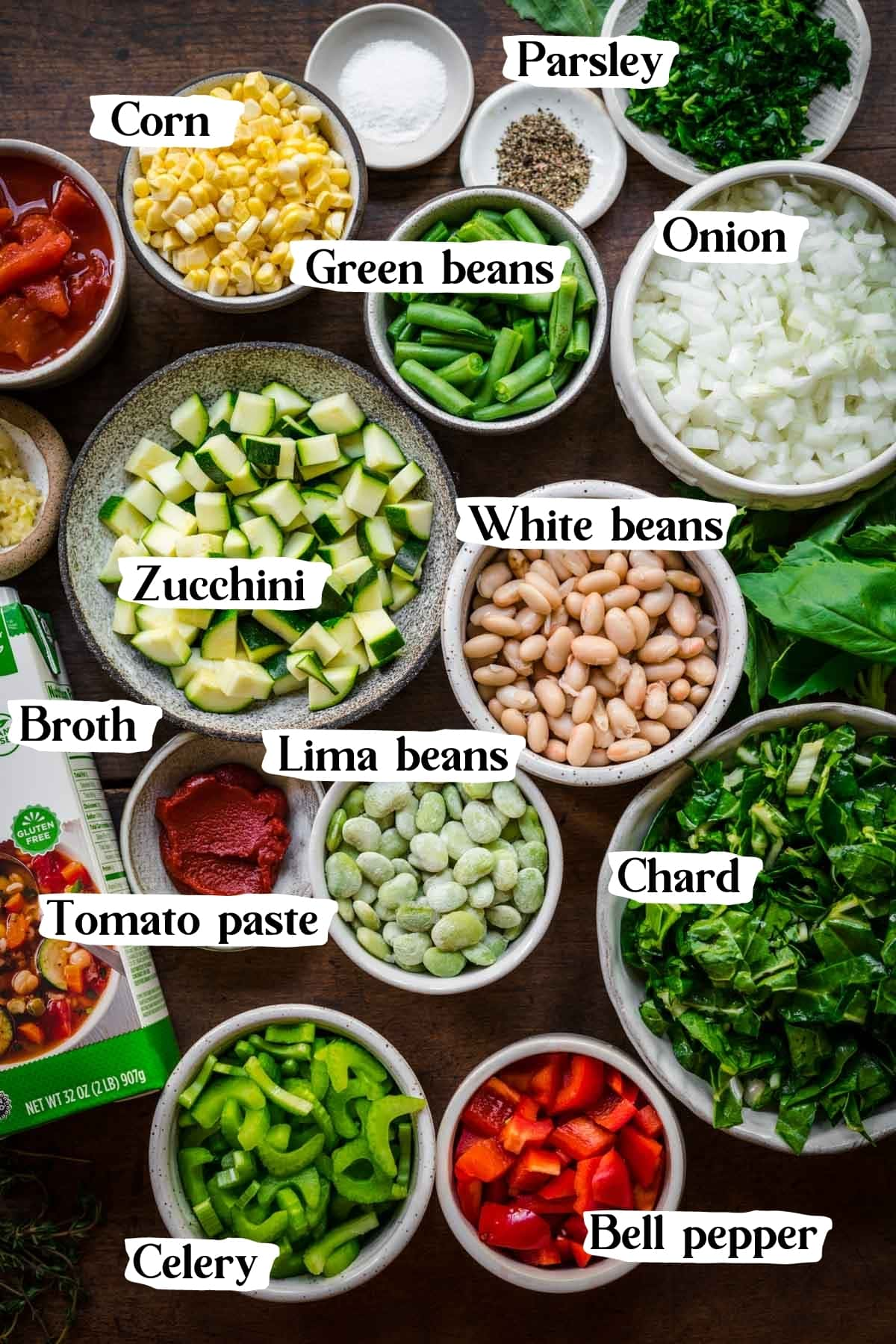 overhead view of ingredients for summer minestrone soup in small prep bowls.