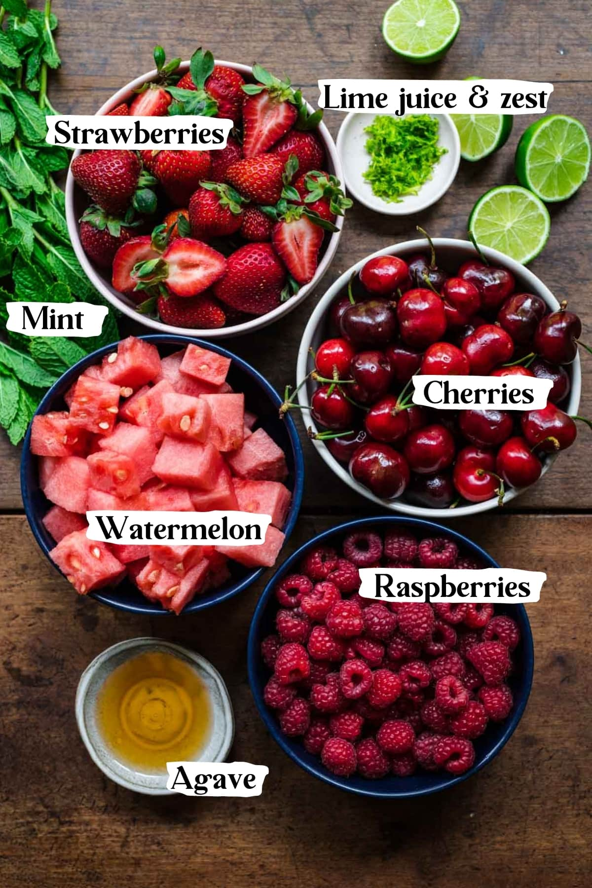 overhead view of ingredients for watermelon berry salad in prep bowls.