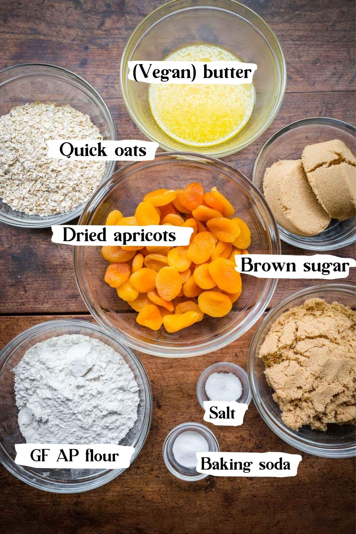 Ingredients you'll need to make the crumble bars, including oats, butter, dried apricots, brown sugar, flour, etc.