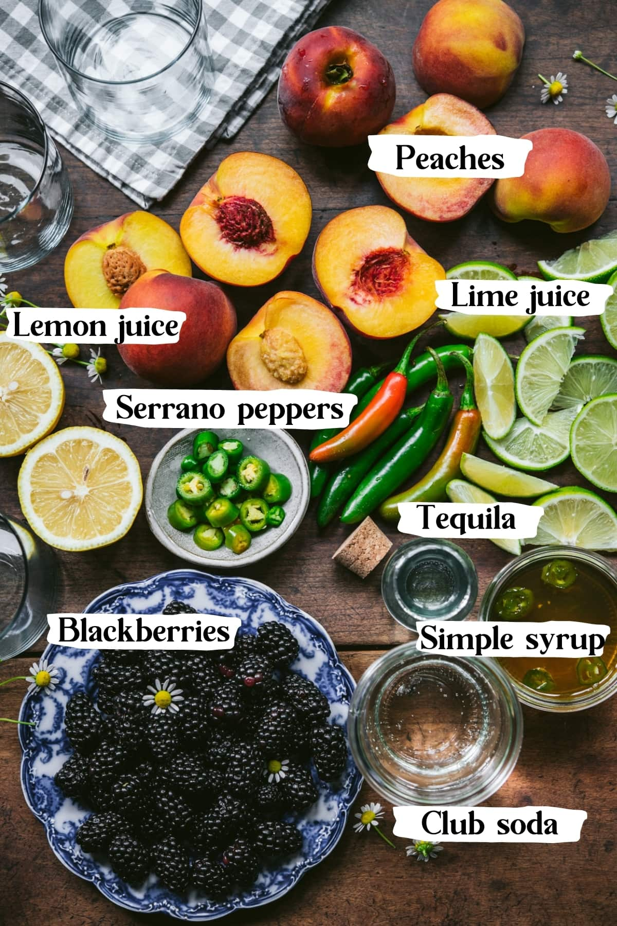 overhead view of ingredients for blackberry peach serrano cocktail.