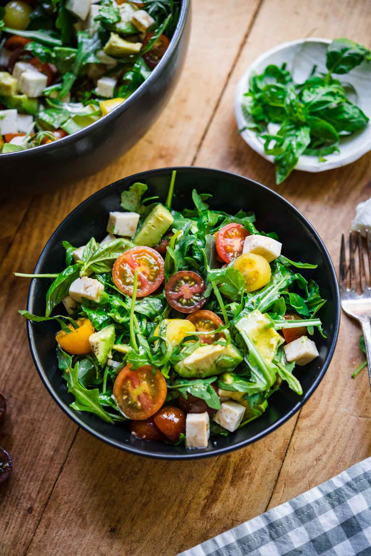 Arugula caprese salad in a small bowl.