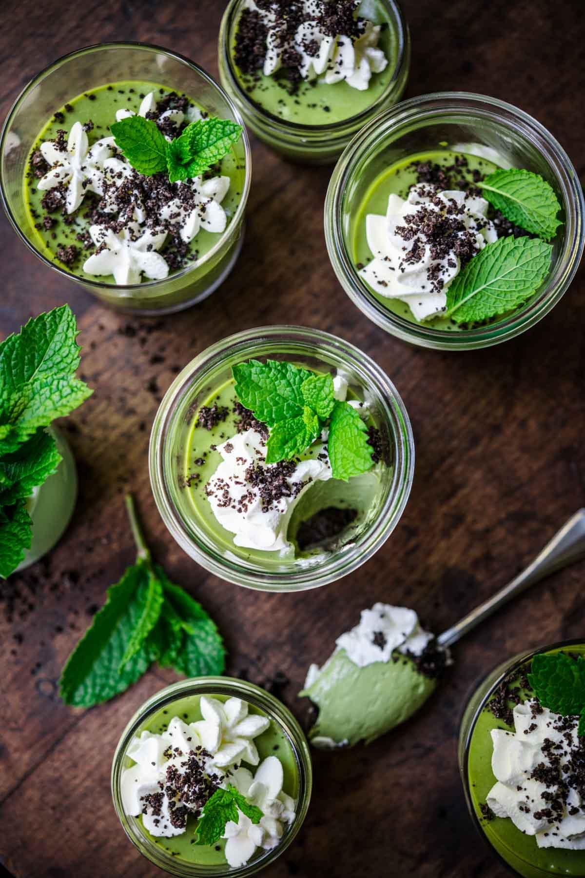 overhead view of vegan mint chocolate cheesecakes in jars.