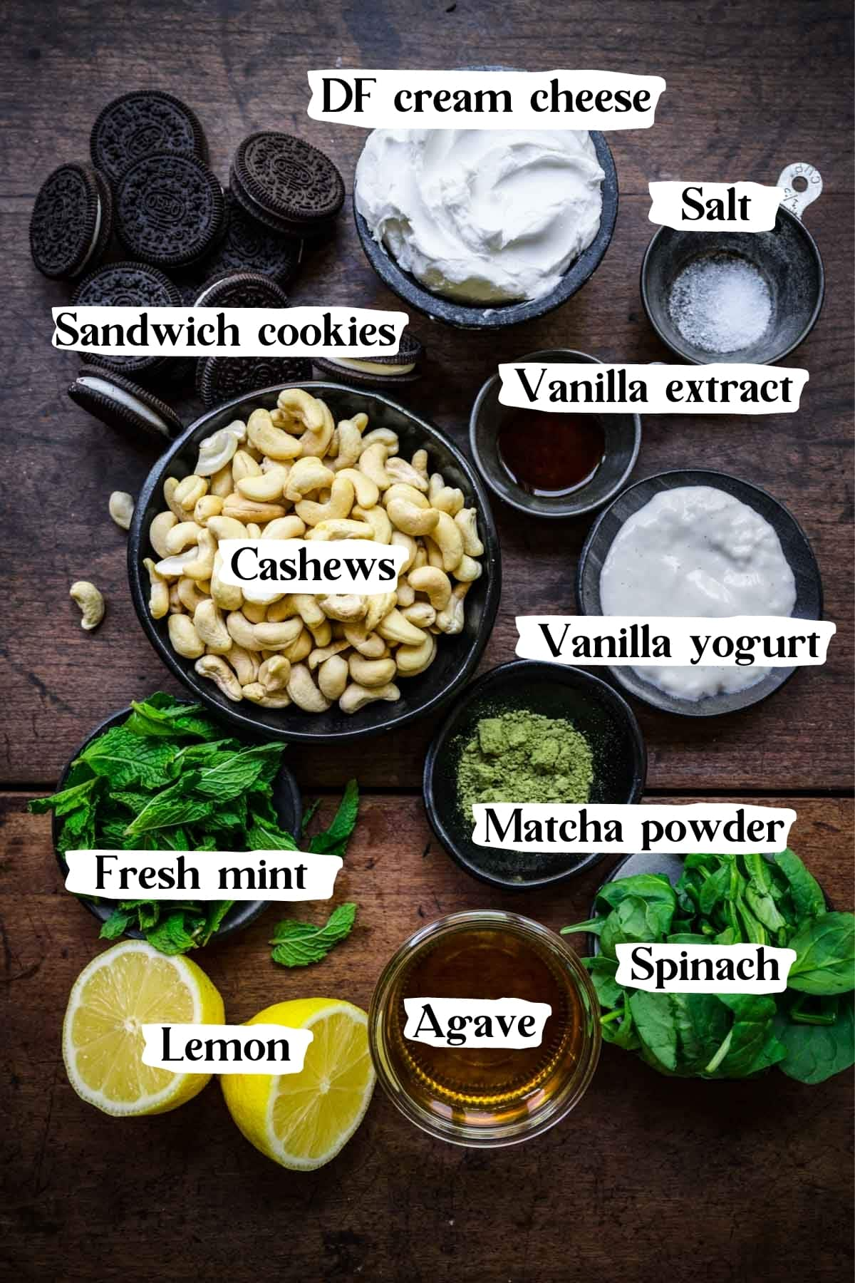 Overhead shot of cheesecake ingredients, including cream cheese, cashews, and cookies.