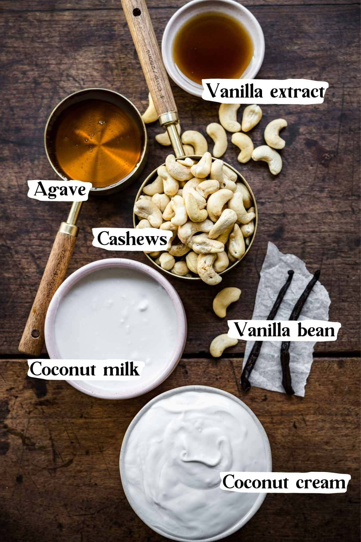 Overhead shot of ingredients including vanilla beans, cashews, coconut milk, etc.