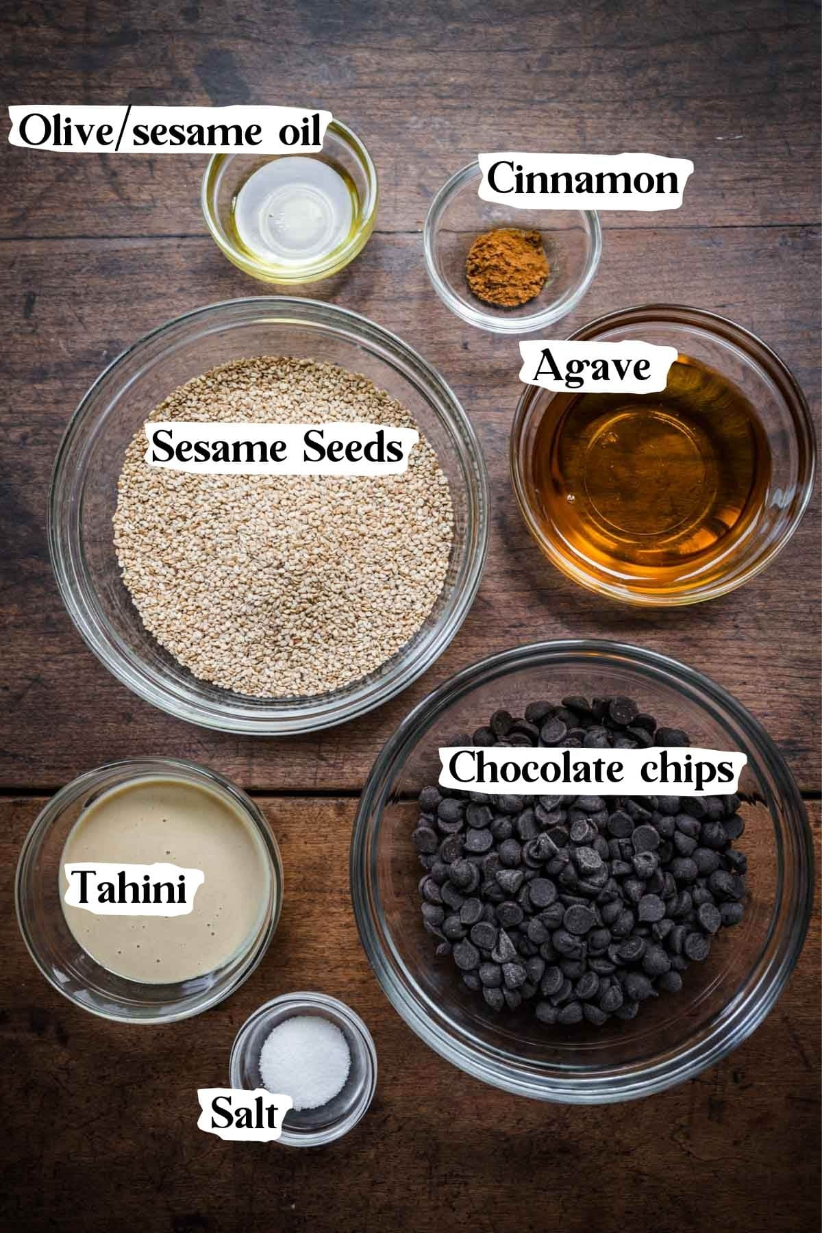 overhead view of ingredients for sesame chocolate bark in small bowls.