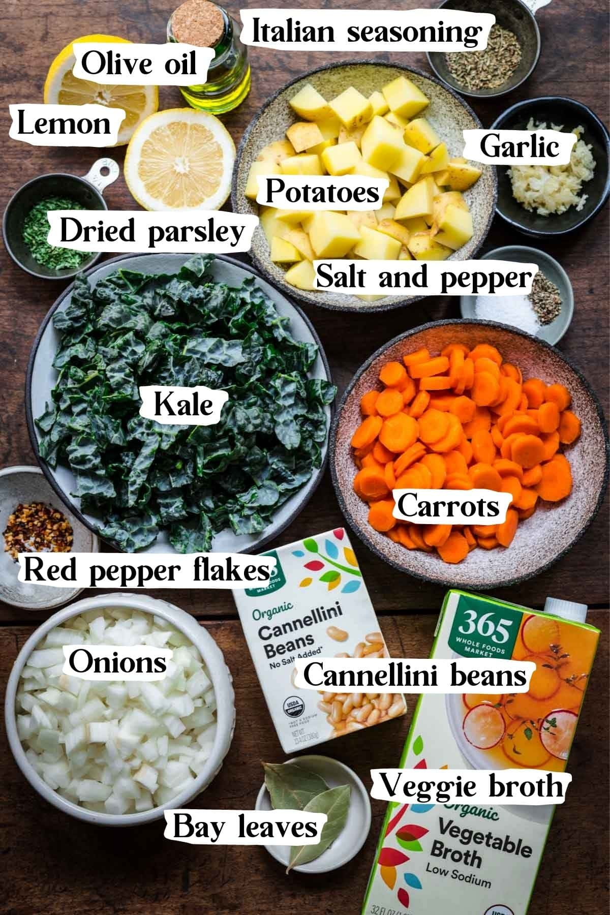 Overhead view of all ingredients, including veggie broth, kale, and white beans.