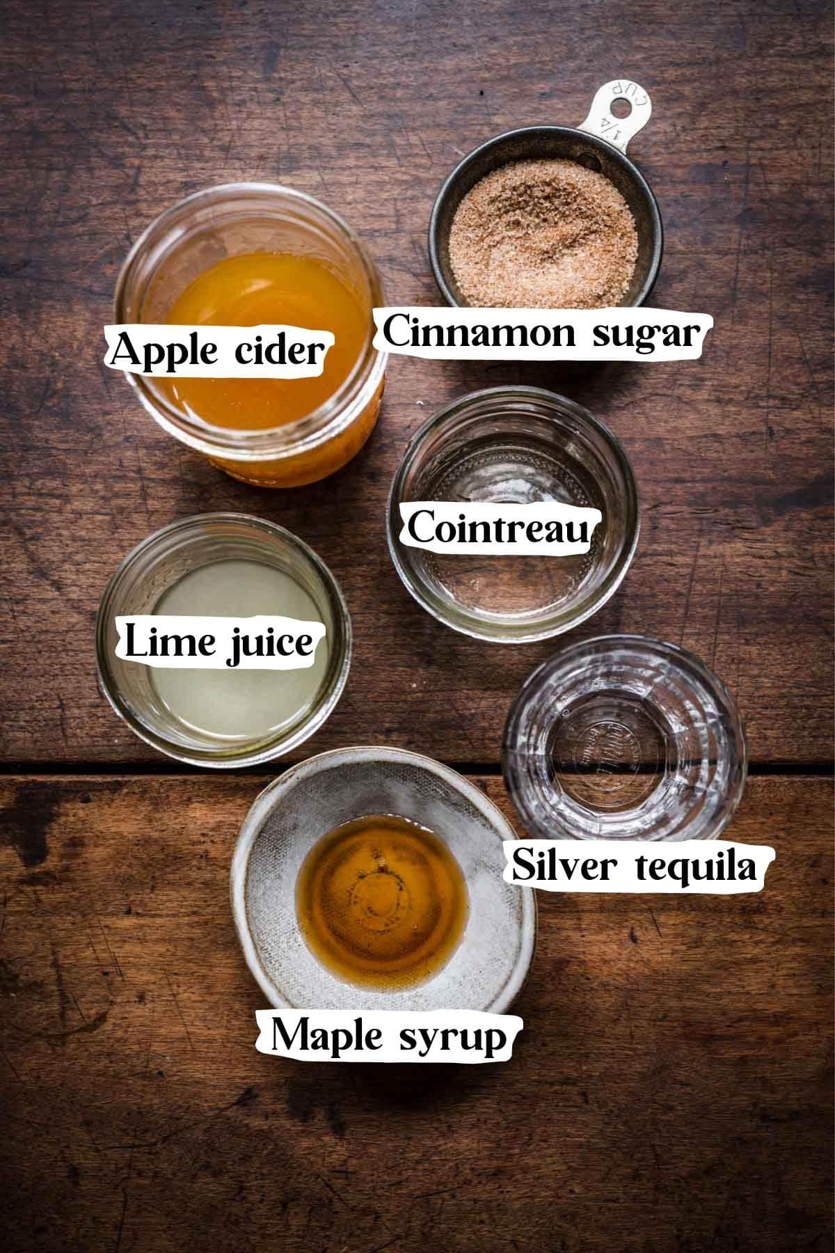 Overhead view of apple cider margarita ingredients.
