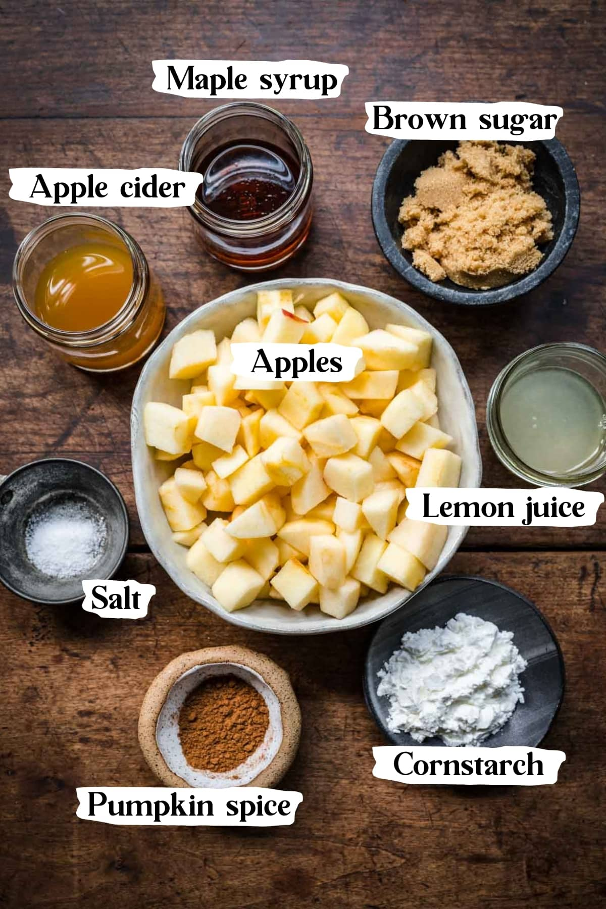 overhead view of ingredients for gluten free apple crisp filling in small prep bowls.