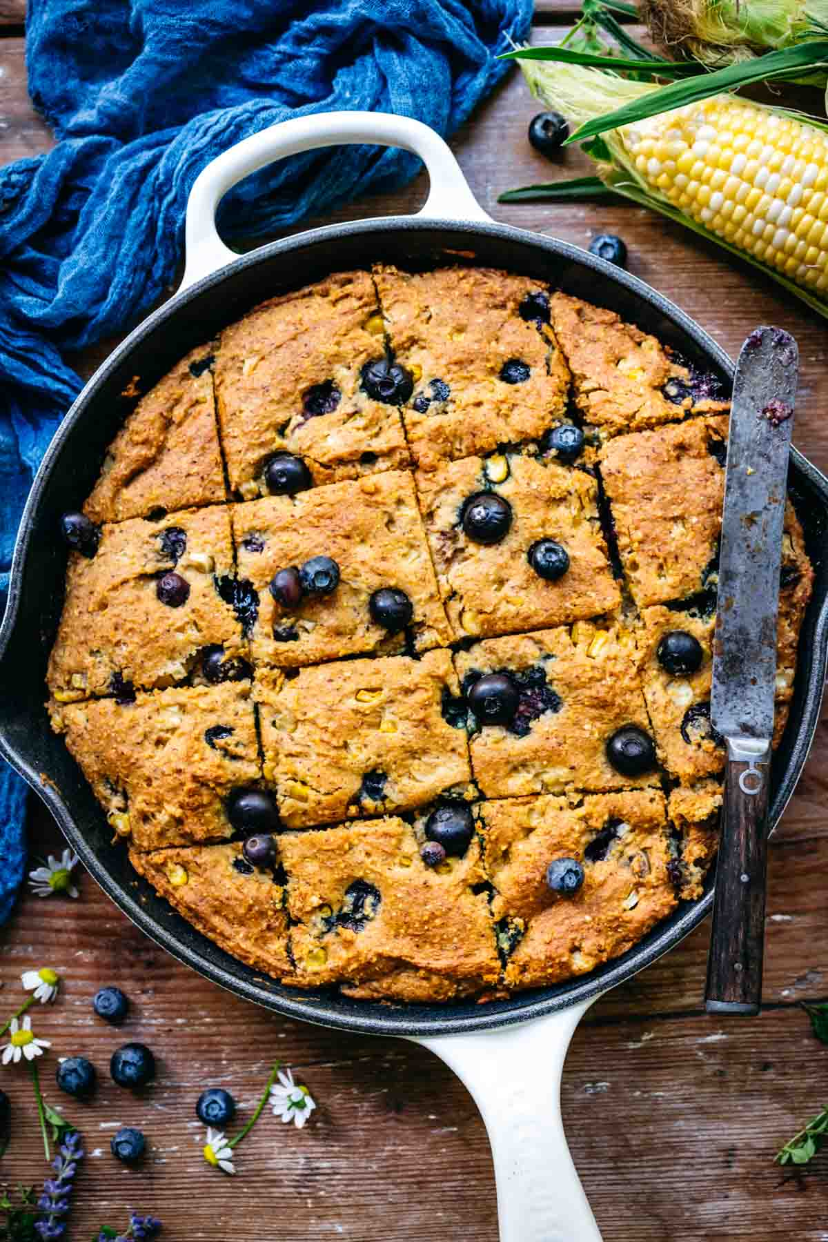 Overhead view of blueberry cornbread in a skillet.