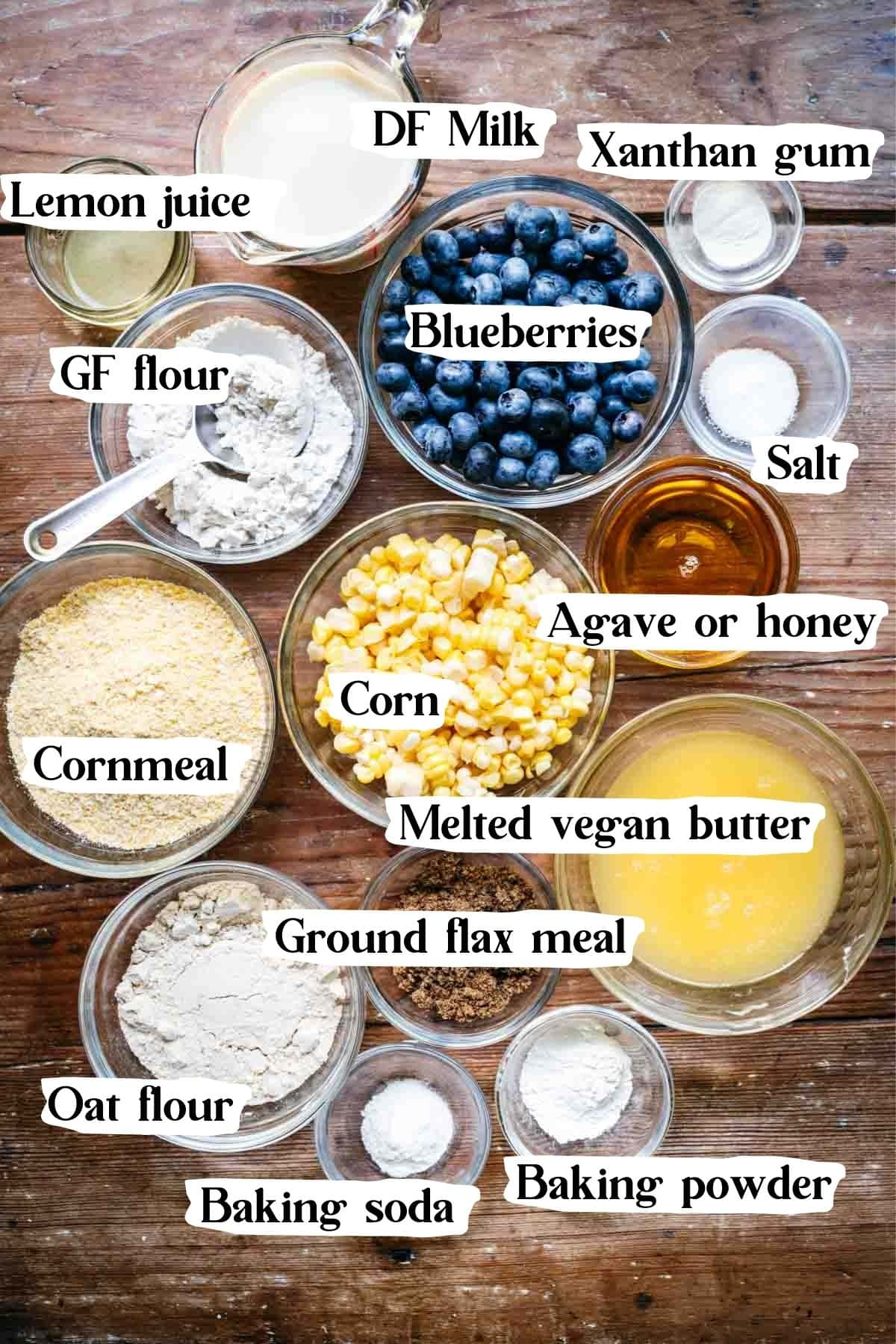 Overhead view of cornbread ingredients in small bowls.