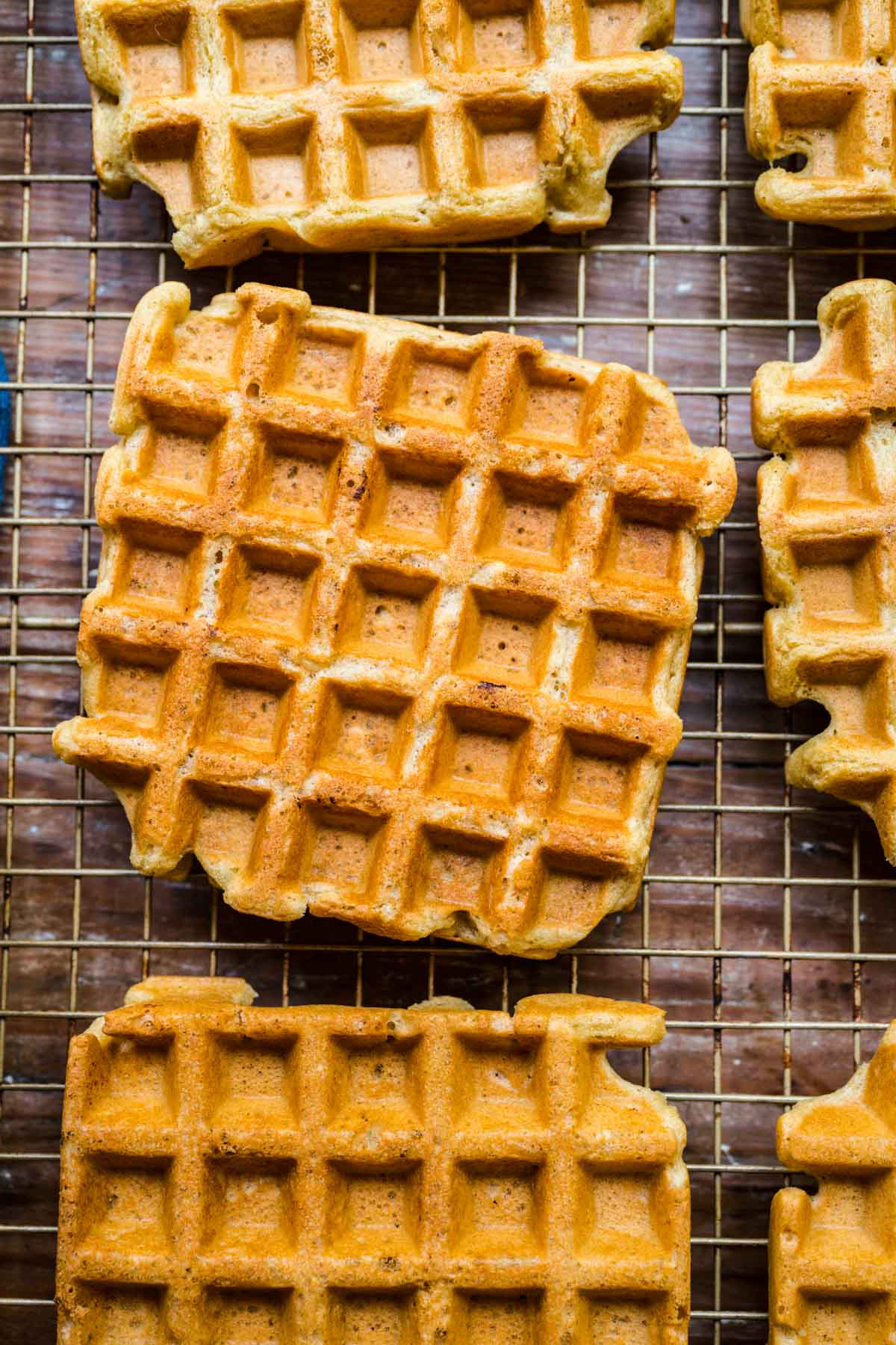 overhead view of vegan waffles on cooling rack.