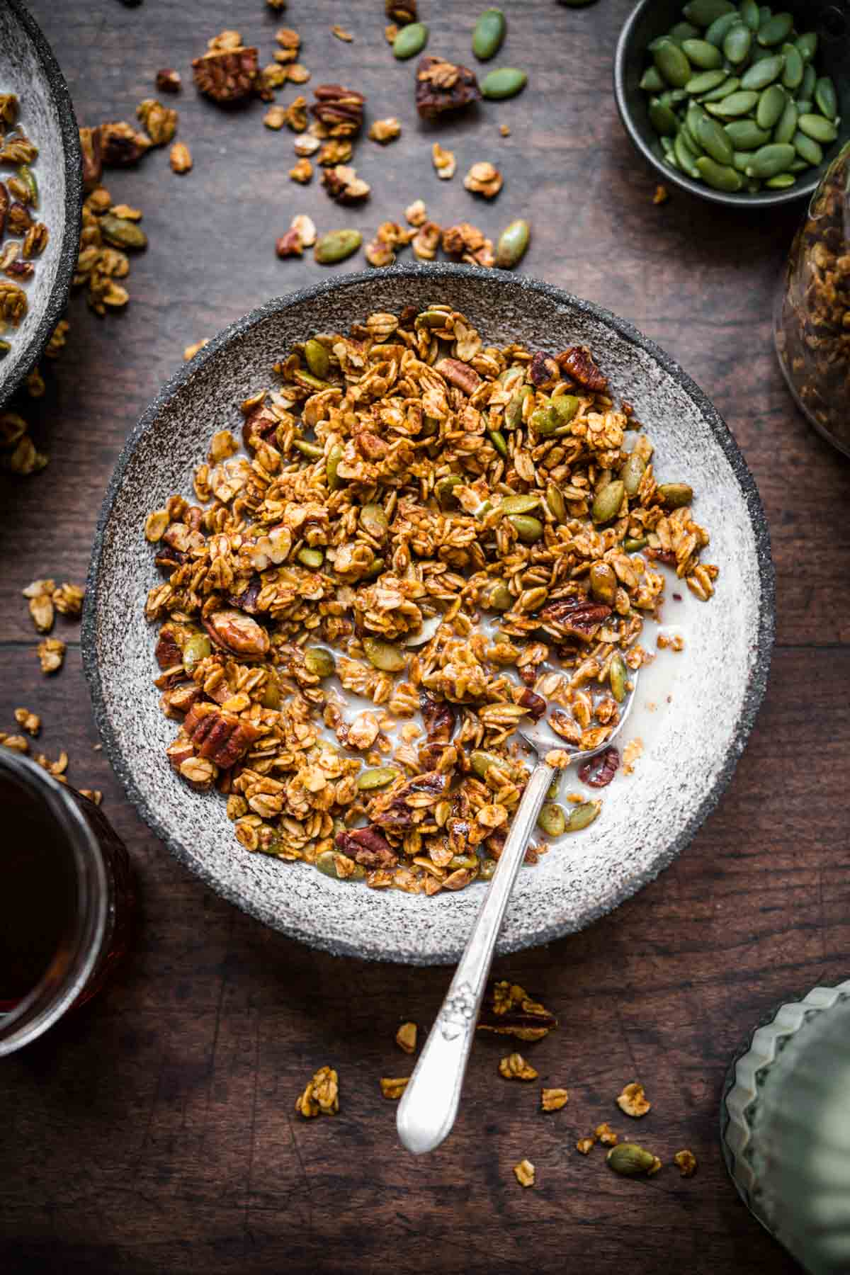 Overhead view of granola in a bowl with milk.