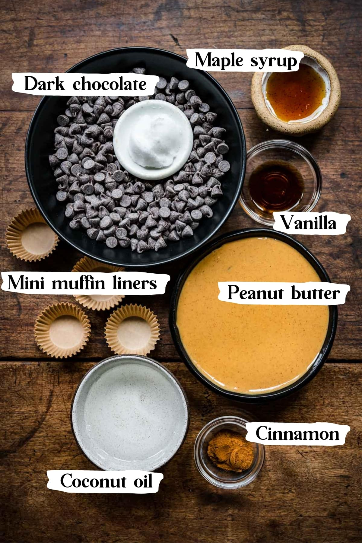 overhead view of ingredients for vegan peanut butter cups in small prep bowls, including chocolate chips and peanut butter.