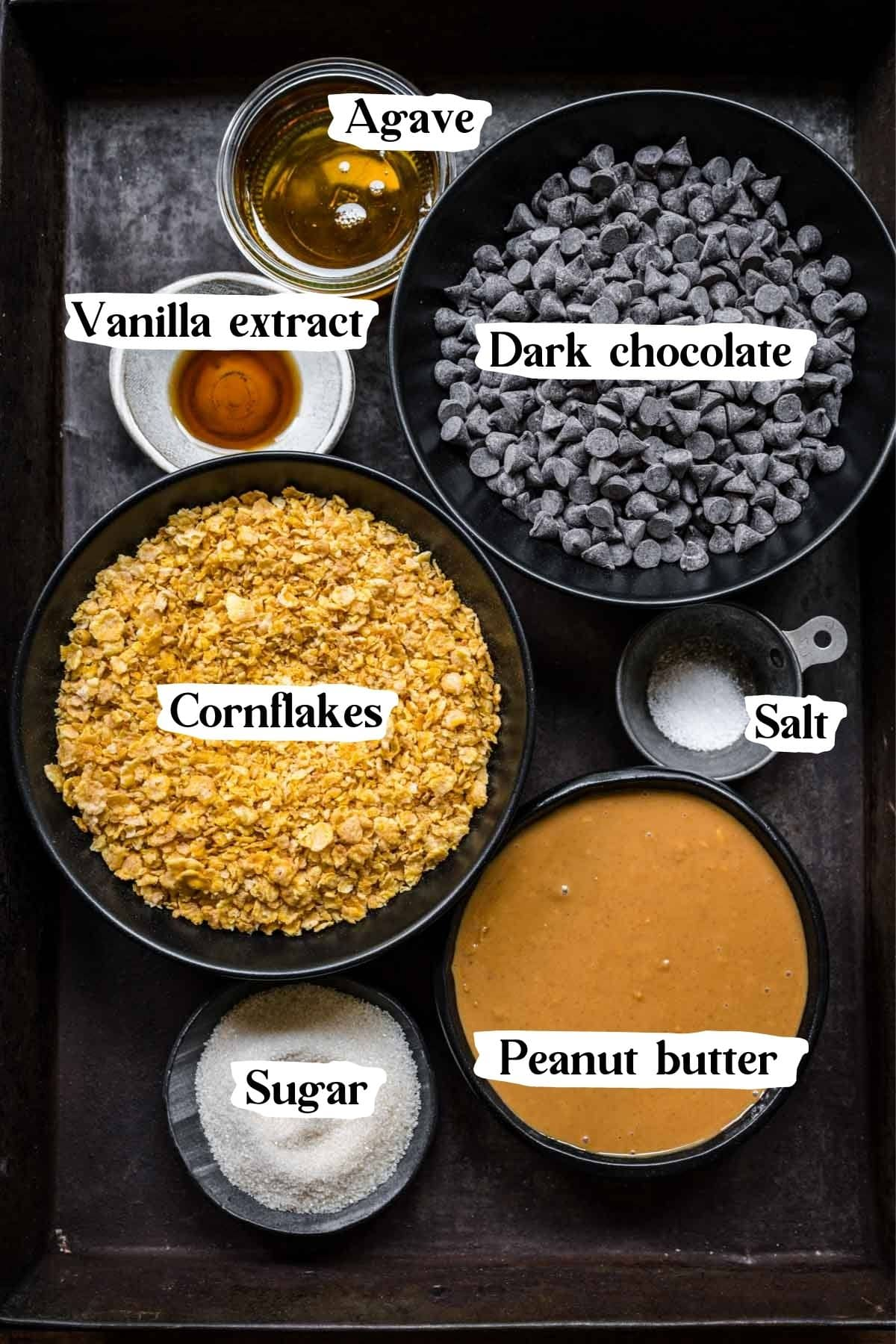 Overhead view of all vegan butterfinger ingredients, including chocolate and cornflakes.