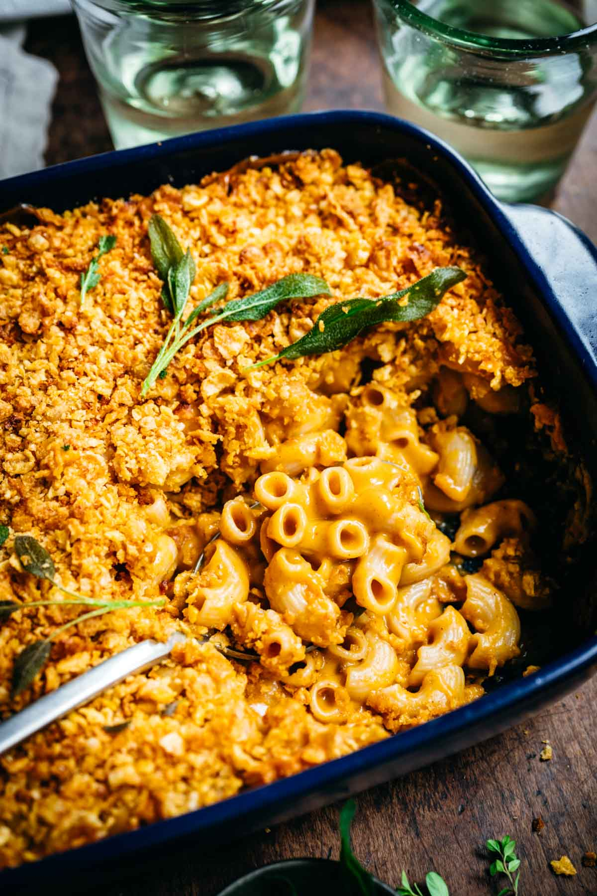 Overhead view of macaroni and cheese in a blue baking dish.