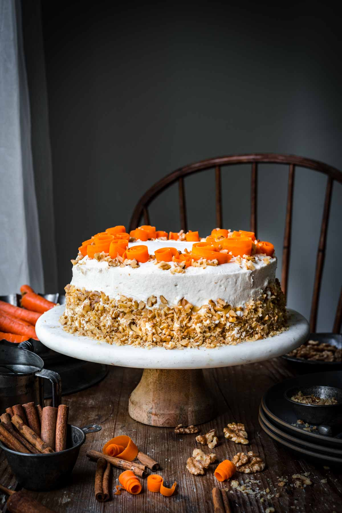 Front view of vegan carrot cake with carrot swirls and crushed walnuts.
