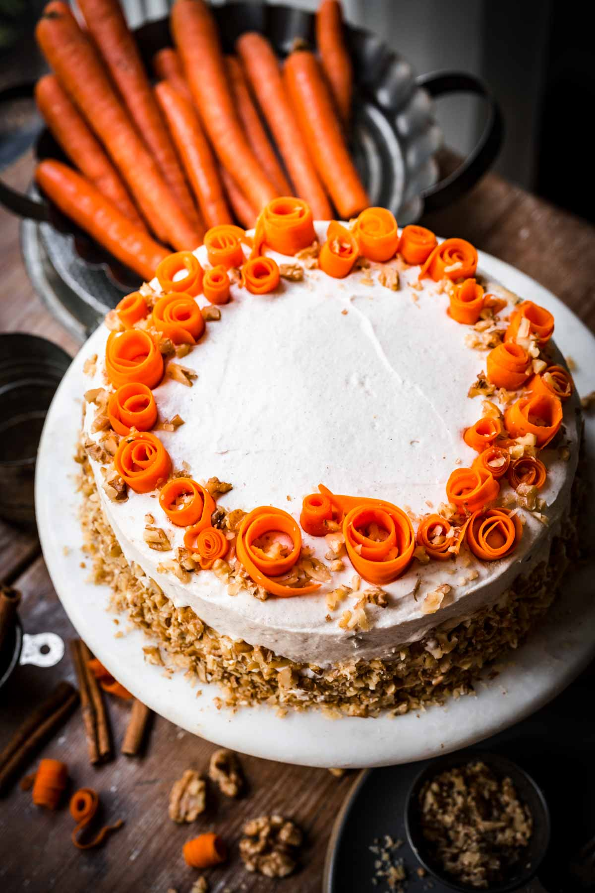 side view of vegan carrot cake on cake stand.