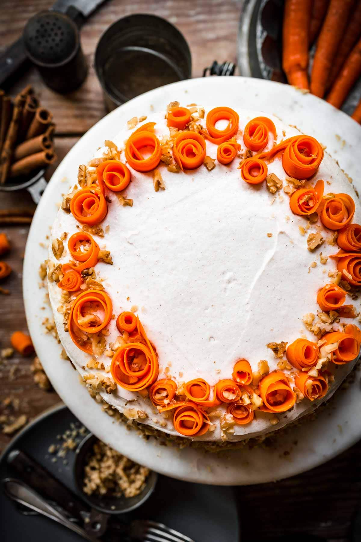 Overhead view of carrot cake on a cake stand.
