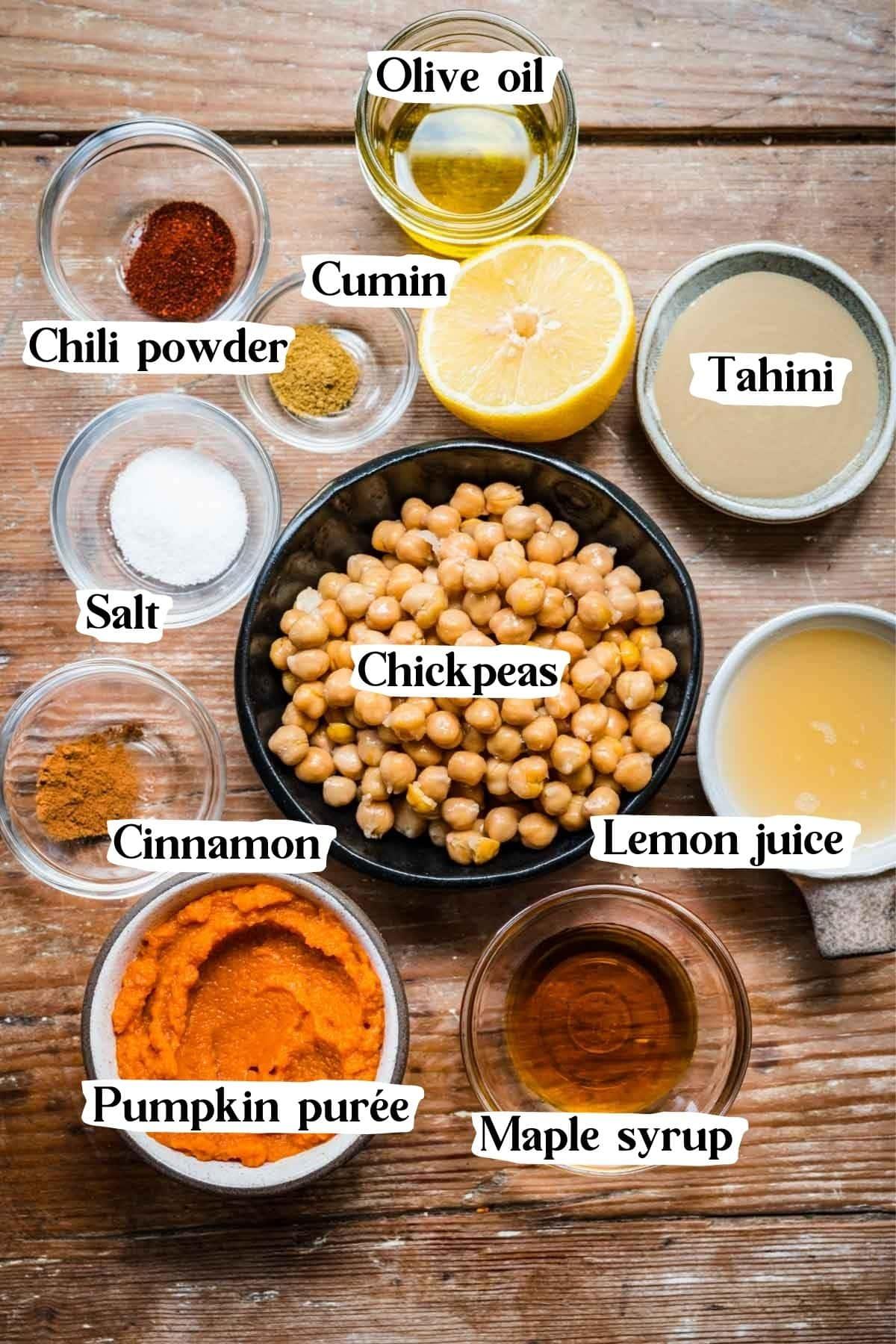 Overhead view of pumpkin hummus ingredients including chickpeas, tahini, and pumpkin puree.
