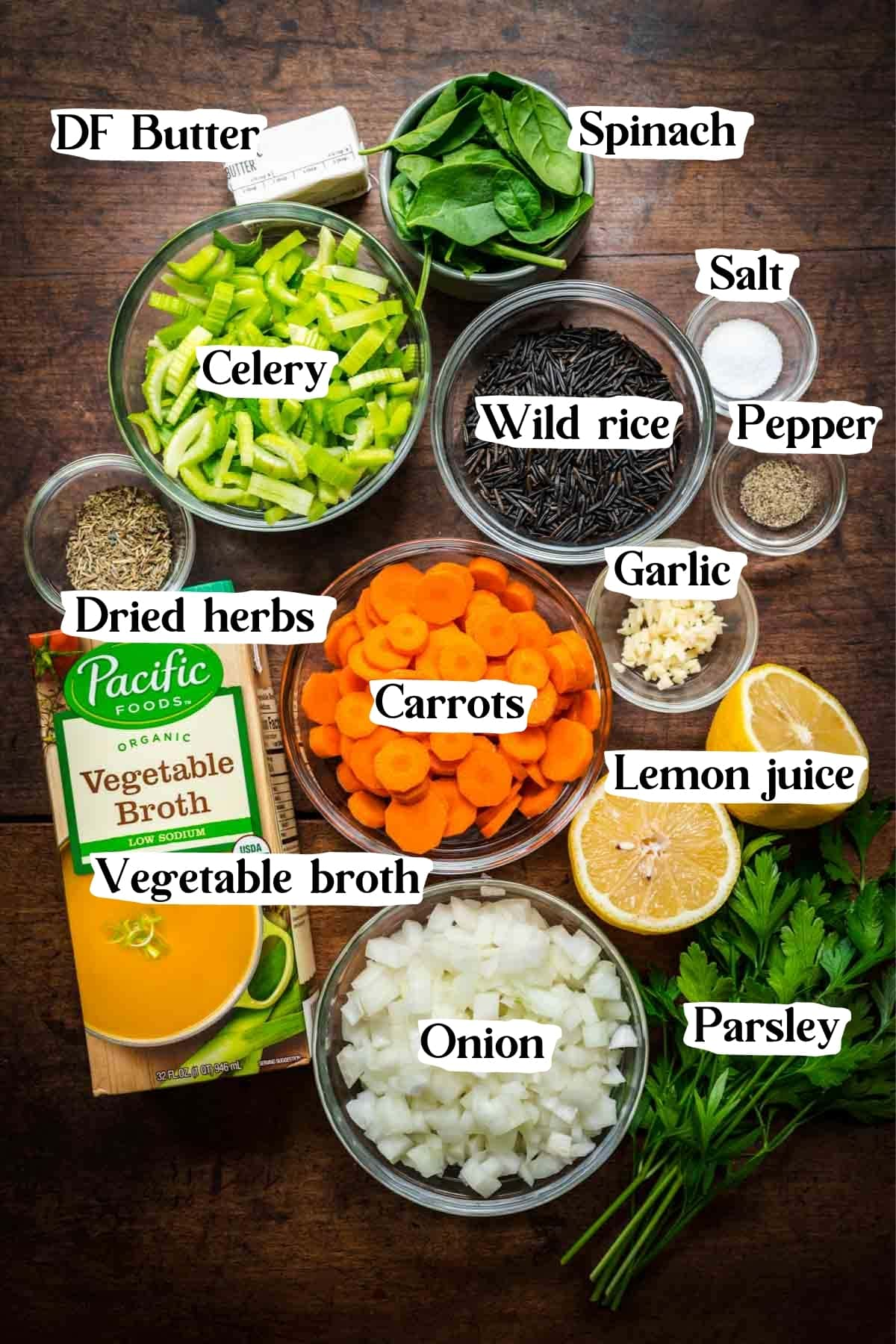 Overhead shot of wild rice soup ingredients, including carrots, celery, onions, and parsley.