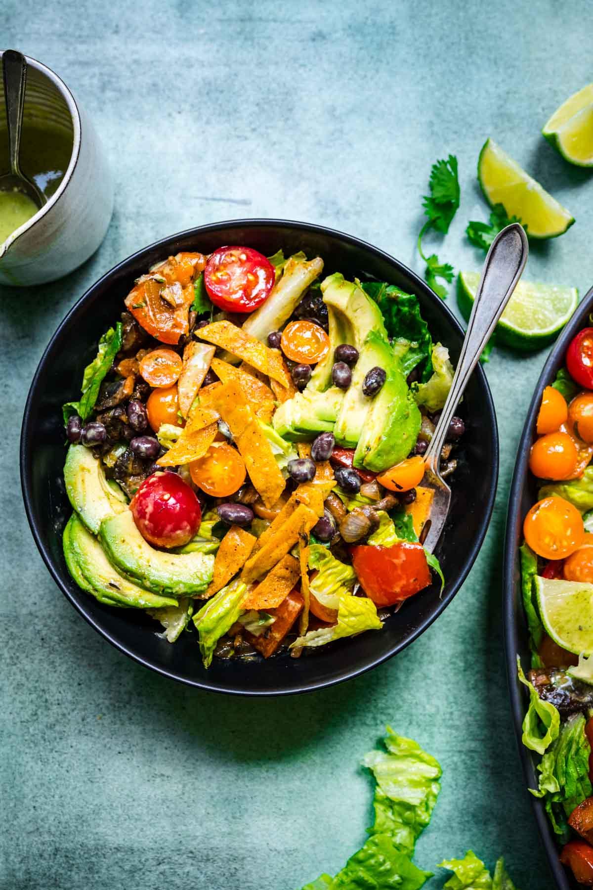 overhead view of fajita vegetable salad in small black bowl.