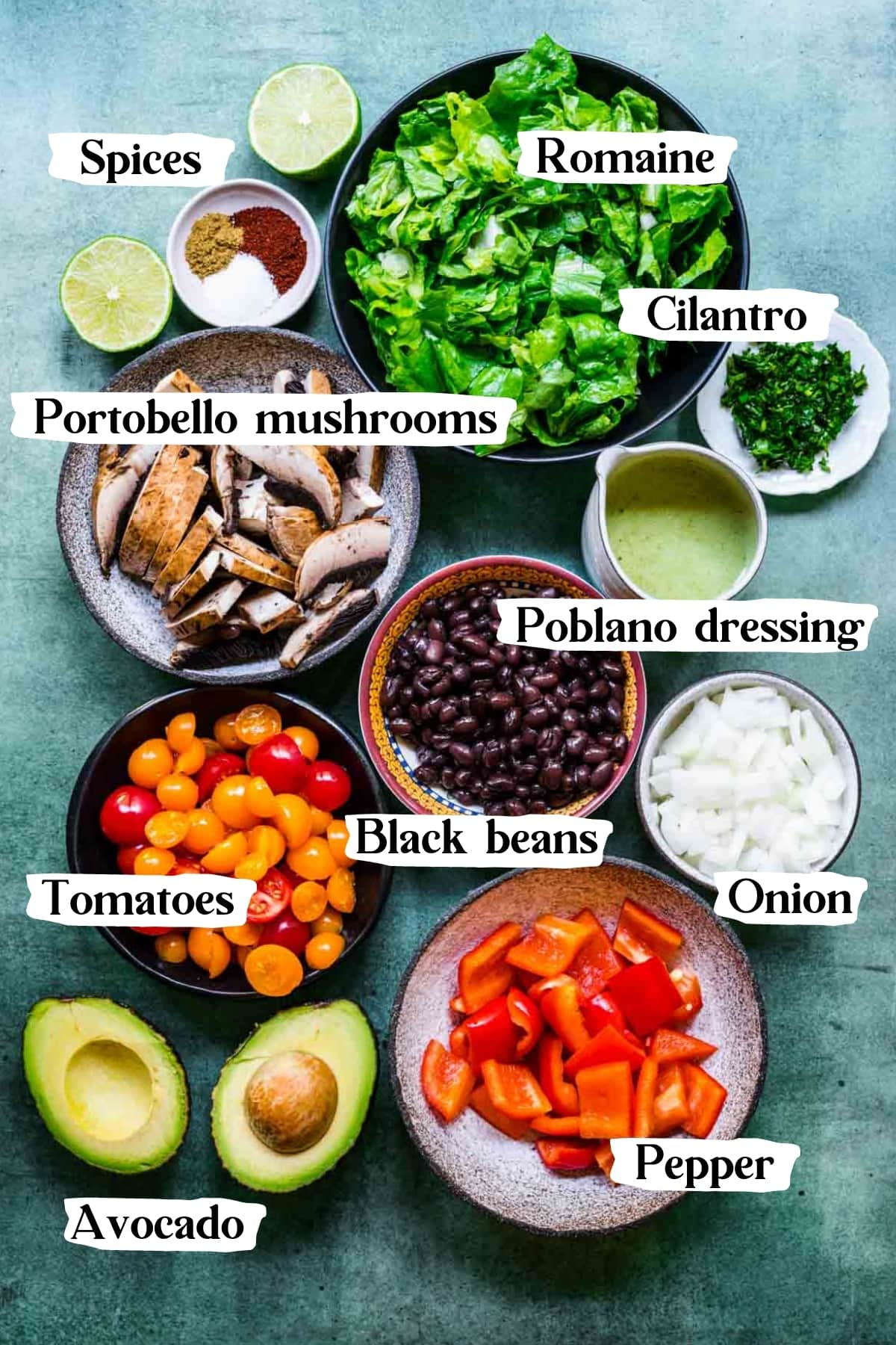 overhead view of ingredients for fajita vegetable salad in small prep bowls.